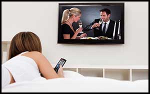 Woman watching a Holiday Movie on TV