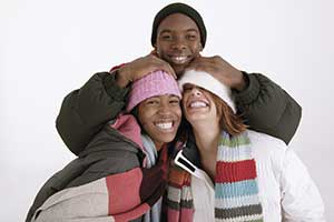 teens wearing hats and scarves